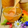 Honey with flowers and briar on the board — Stock Photo