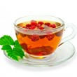 Tea with raspberries and a leaf in a cup — Stock Photo #35042841
