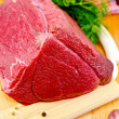 Meat of a beef on the board in one piece — Stock Photo