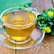 Herbal tea with a bouquet of Rhodiola rosea on the board — Stock Photo