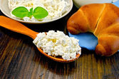 Curd on a wooden spoon on a board — Stock Photo