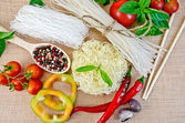 Noodles rice different with vegetables on sacking — Stock Photo