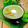Puree of spinach with croutons on the board — Stock Photo #36401149