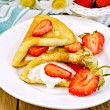 Pancakes with strawberries and cream on the board — Stock Photo