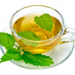 Stock Photo: Herbal tea with nettles in a glass cup
