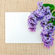 Lilac on sackcloth with paper — Stock Photo #37477777