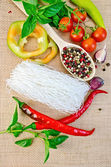 Noodles rice white with a variety peppers — Stock Photo