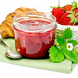 Stock Photo: Jam of strawberry with a croissant