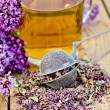 Herbal tefrom oregano with strainer in glass mug — Stockfoto #40952369