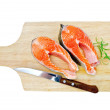 Foto de Stock  : Trout on board with knife and rosemary