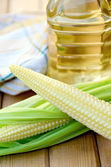 Corncob with oil on board — Stockfoto