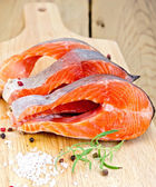 Trout on board with rosemary and salt — Stock Photo