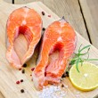 Foto de Stock  : Trout on board with lemon and rosemary