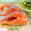 Стоковое фото: Trout with oil and salt on board