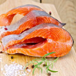 Стоковое фото: Trout with salt and rosemary on board