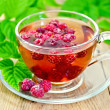 Tea with raspberry and green leaves on board — Stock Photo #42905515