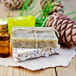 Oil and soap different cedar cones on board — Stockfoto