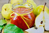 Jam pear with pears and leaves on board — Stock Photo