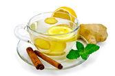 Tea ginger with lemon and cinnamon — Stock Photo