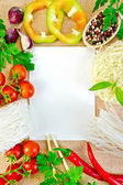Frame of vegetables and funchozy with paper on sackcloth — Stock Photo