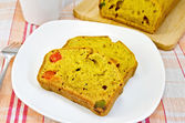 Fruitcake pumpkin with candied fruit on plate and napkin — Stock Photo