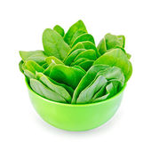Spinach in a green bowl — Stock Photo