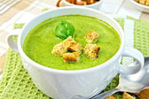 Soup puree with spinach and spoon on a napkin — Stock Photo