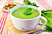 Soup puree with spinach leaves on fabric — Стоковое фото