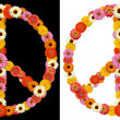 Peace symbol made from flowers - Stock Photo
