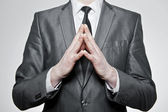 Businessman with hands folded together — Stock Photo