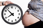 Belly and clock — Stock Photo