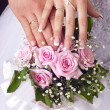 Wedding bouquet from tender roses, hands and rings — Stock Photo #11108274