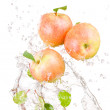 Three juicy red apple in water splash isolated on a white backgr — Stock Photo