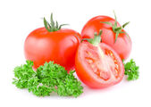 Two Fresh Juicy tomato cut in half and a sprig of parsley Isolat — Stock Photo