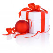 White boxs tied with a red satin ribbon bow and christmas ball I — Stock Photo