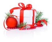 Christmas gift, red ribbon, tree branch and christmas ball Isola — Stock Photo