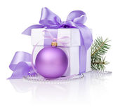 Christmas gift with Purple Ball, tree branch and ribbon bow isol — Stock Photo