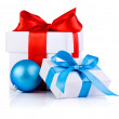 Two White boxs tied with a satin ribbon bow and blue Christmas b — Stock Photo