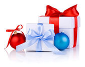 Two White boxs tied with a satin ribbon bow, red and blue Christ — Stock Photo