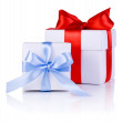 Two White boxs tied with Red and Blue satin ribbon bow isolated — Stock Photo