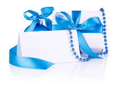 Christmas Card and gift with Blue Ball, ribbon bow, beads isolat — Stock Photo