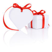 Valentines Day gift in white box and heart red ribbon isolated o — Stock Photo