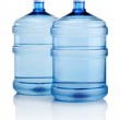 Two big bottles of water isolated on a white background — Stock Photo