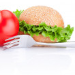 Sandwich bun with lettuce, juicy red tomato and fork, isolated o — Stock Photo