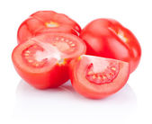 Juicy red tomatoes cut Isolated on white background — Stock Photo