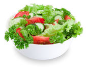 Bowl of mixed salad against a white background — Stock Photo