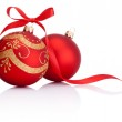 Two Red christmas decoration balls with ribbon bow isolated on w — Stock Photo #35266111