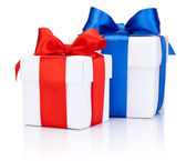 Two White boxs tied with Red and Blue satin ribbon bow Isolated — Stockfoto