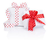 Two White boxs tied satin ribbon with heart symbol bow Isolated — Stock Photo