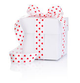 White box tied satin ribbon with heart symbol bow Isolated on wh — Stock Photo